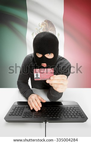 Hacker with ID card in hand and flag on background - Mexico - stock photo