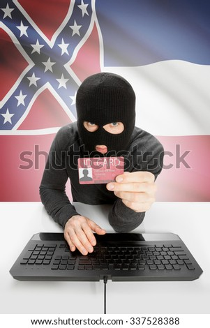 Hacker with ID card in hand and USA states flag on background - Mississippi - stock photo