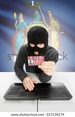 Hacker with ID card in hand and USA states flag on background - New York - stock photo