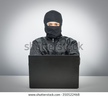 Hacker with laptop isolate on white background