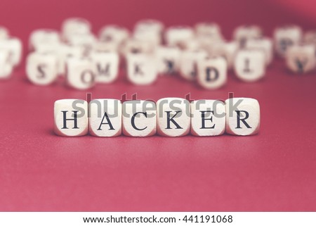 Hacker word written on wood cube with red background - stock photo