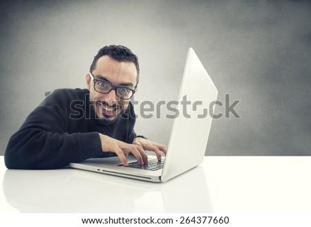 Hacker working on laptop  - stock photo