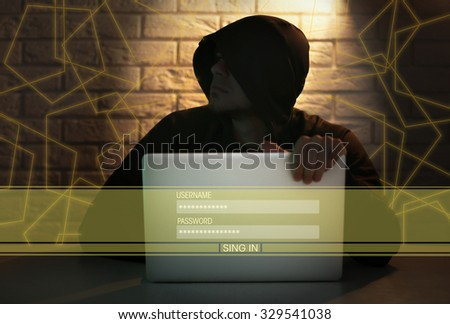 Hacker working with computer - stock photo