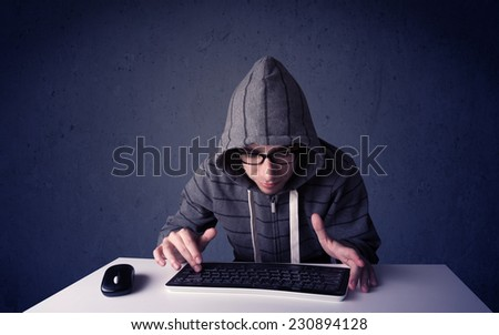 Hacker working with keyboard and mouse on blue background - stock photo