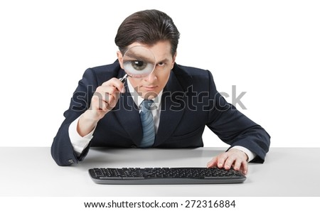Hacking. Businessman looking in a computer for virus and hacker - stock photo