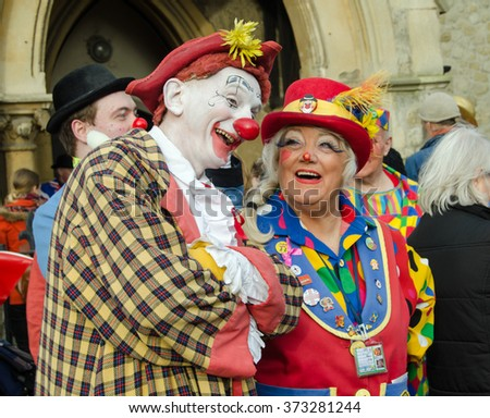 HACKNEY, LONDON - FEBRUARY 7, 2016: Female clown Pip jokes with a colleague before the Annual Clown Service in memory of Joseph Grimaldi at All Saints Church, Haggerston, Hackney in London's East End.