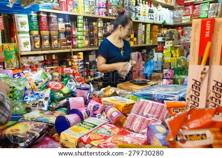 Had-Yai, Thailand - June 5, 2015 female seller in market with many snack for sell in Gim-Yong Market, Gim-Yong Market is the famous of south Thailand.