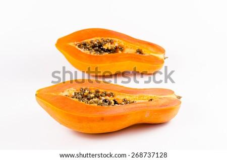 haft of fresh papaya isolated on white background - stock photo