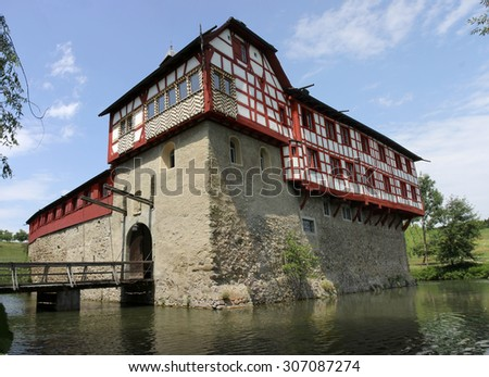 HAGENWIL, SWITZERLAND - JULY 19, 2015: the moated castle in Hagenwil, built during the 13th century. It is a Swiss heritage site of national significance. July 19, 2015, Hagenwil, Switzerland. - stock photo