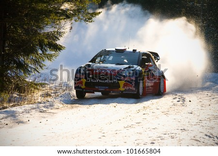 HAGFORS, SWEDEN - FEB 9: LOEB Sebastien  in his Citroen DS3 WRC during the Shakedown stage in  Rally Sweden 2012 in Hagfors , Sweden on Feb 9, 2012 - stock photo