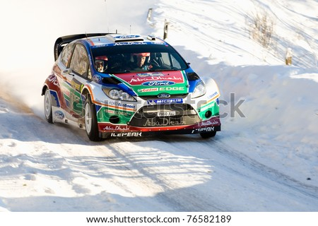 HAGFORS, SWEDEN - FEB 10: Mikko Hirvonen drivning his Ford Fiesta RS WRC during the World Rally Championship event Rally Sweden in Hagfors, Sweden on Feb 10, 2011.  Winner WRC Rally Sweden 2011 - stock photo