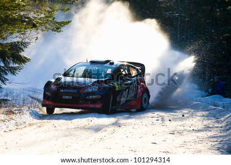 HAGFORS, SWEDEN - FEB 09: SOLBERG Henning in his Ford Fiesta WRC during the Shakedown stage in  Rally Sweden 2012 in Hagfors, Sweden on Feb 9, 2012 - stock photo