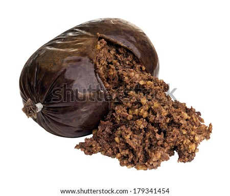 Haggis a traditional Scottish sausage made from sheep stomach and filled with sheeps liver, lungs and heart, oatmeal, onion, suet and seasoning. - stock photo