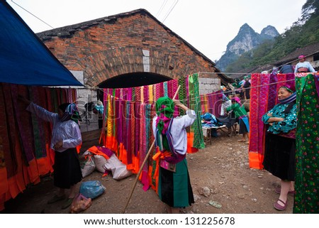 HAGIANG, VIETNAM - OCTOBER 17: Unidentified women of the Flower H'mong Ethnic Minority People at market on October 17, 2010 in Ha Giang, Vietnam. H'mong are the 8th largest ethnic group in Vietnam. - stock photo