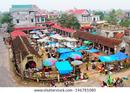 HAI DUONG, VIETNAM, April, 30: People go to Gold market on April, 30, 2013 in Thanh Ha, Hai Duong,Vietnam. This is the oldest stock market in rural Vietnam was built in 1845 - stock photo