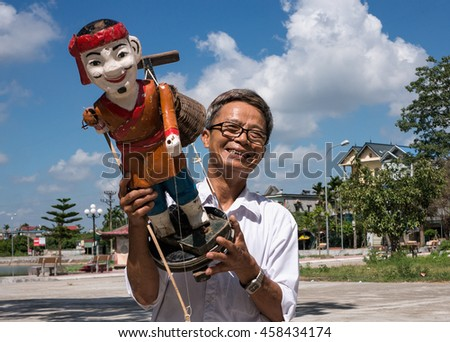 HAI DUONG, Vietnam, July 25, 2016 HAI DUONG, Vietnam, July 25, 2016 man (name unknown) the water puppets, rural Hai Duong, Vietnam