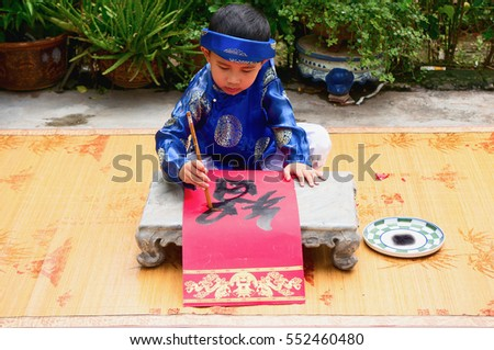 HAI DUONG, Vietnam, September 2, 2016 children, dressed in traditional costumes. Favorite write out, word drought