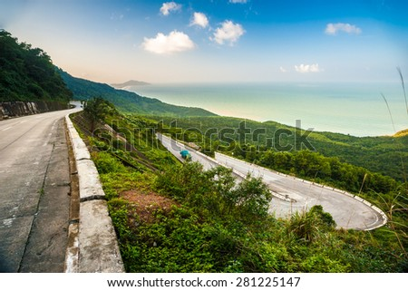 Hai Van pass - the famous road which leads along the coastline mountains near Da Nang city, Vietnam. Beautiful nature and transportation background.