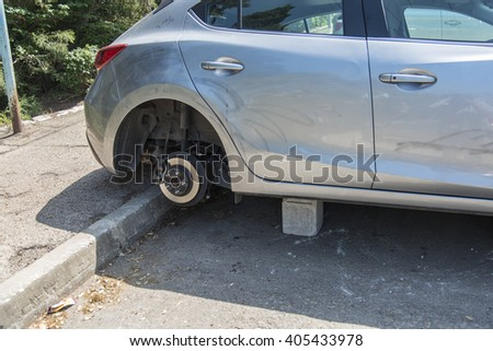 Haifa, Israel, April 4, 2016 : Car with four stolen wheels