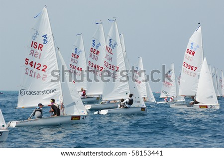 HAIFA, ISRAEL - JULY 30: Participants compete in the International Yacht 420 Word Championship 2010 on July 30, 2010 in Haifa, Israel - stock photo