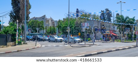 HAIFA, ISRAEL - MAY 11, 2016:  Scene of Yom Hazikaron (Israel Memorial Day for its soldiers), with people and traffic observe a two-minute standstill to a sound of a siren. Haifa, Israel