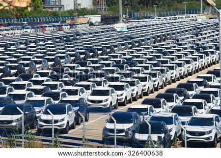 Haifa, Israel - October 11, 2015: Rows of new cars covered in protective white sheet parked in Haifa's port platform
