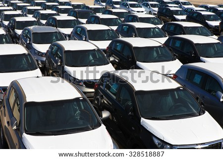 Haifa, Israel - October 16, 2015: Rows of new cars covered in protective white sheet parked in Haifa's port platform