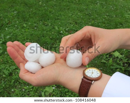 Hail after storm in hand - stock photo