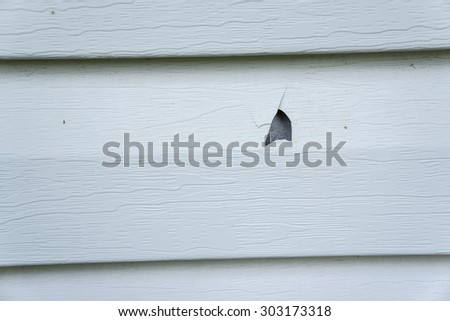 Vinyl siding stock images royalty free images vectors for Hail damage vinyl siding