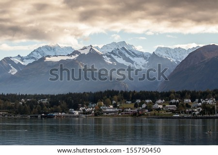 Haines Alaska across Portage Cove with storm clouds over the mountains.