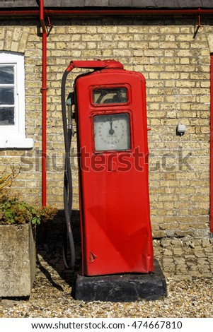 HAINTON, ENGLAND - AUGUST 26: Old fashioned, vintage red petrol (gas) pump next to the Heneage Arms pub. In Hainton, Lincolnshire, England. On 26th August 2016.