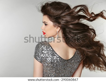 Hair. Beautiful Brunette Girl. Healthy Long Hair. Beauty Model Woman. Blowing Hairstyle.