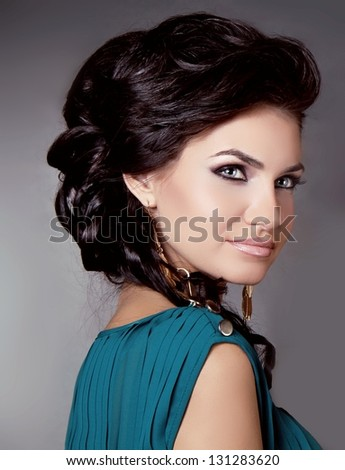 Hair. Beautiful Brunette Girl. Sensual brunette woman with Hair Styling - stock photo