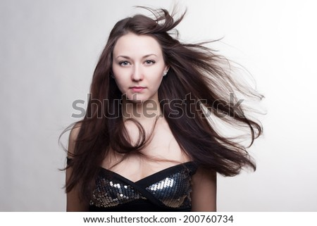 Hair. Beautiful Brunette woman. Healthy Long Hair. Beauty Model Girl. Hairstyle. Portrait of a beautiful brunette girl with fluttering hair.