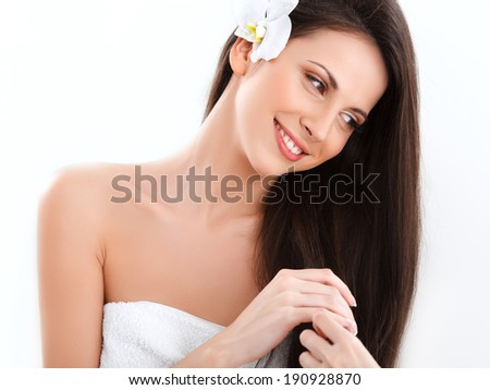 Hair. Beautifull Woman with Long Healthy and  Brown Hair. Brunette Girl isolated on a white background. - stock photo