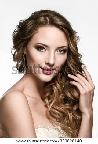 Hair. Beauty Fashion Model Woman touching her Long Wavy and Healthy Brown Hair. Beauty Brunette Girl on white background. - stock photo