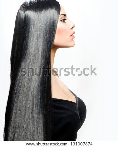 Hair. Beauty Girl with Long Straight Black Healthy Hair. Beautiful Brunette Woman Portrait. Perfect Hair - stock photo