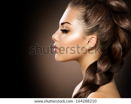 Hair Braid. Beautiful Woman with Healthy Long Hair. Hairdressing. Hairstyle. Beauty Glamour Fashion Model Girl Portrait. Perfect Skin and Makeup  - stock photo