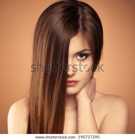 Hair care. Beauty portrait of teenage girl with shiny healthy hair posing in studio. Young sensual Caucasian female touching her skin.  - stock photo