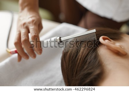 Hair Care. Closeup Of Cosmetologist Brushing Woman's Beautiful Healthy Long Hair With Comb For Keratin Supply At Beauty Salon. Hair Treatment With Brush At Cosmetology Center. High Resolution Image