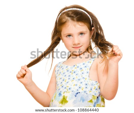 Hair care concept with portrait of young girl holding her long hair isolated on white - stock photo