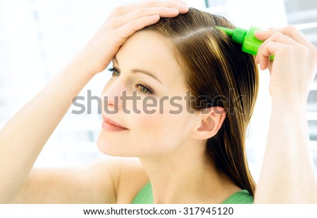 hair care, woman combing her long straight healthy hair