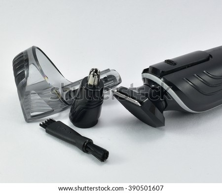 Hair clipper or trimmer, nose extension and clean brush isolated on white background