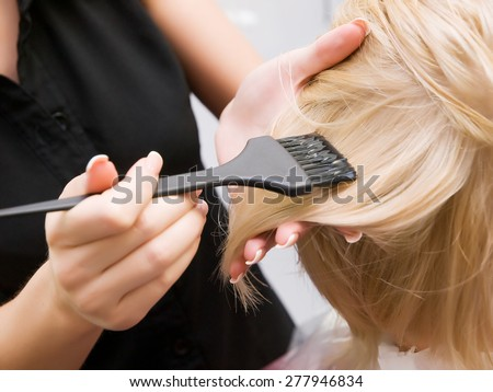 hair coloring in the salon. process - stock photo