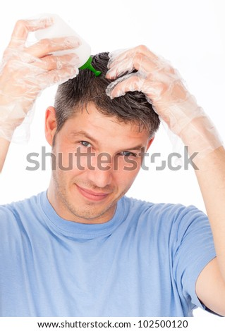 hair coloring man agains grey hair