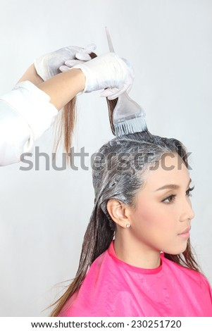 Hair Colouring in process - stock photo
