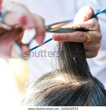 Hair cut at a hairdresser salon. - stock photo