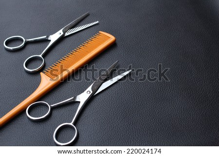 Hair cutting shears and comb - stock photo