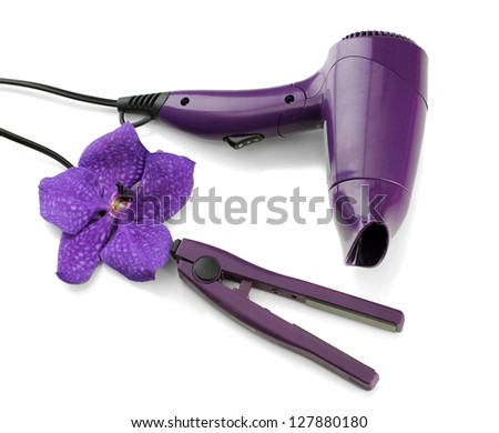 Hair dryer and straighteners , isolated on white - stock photo