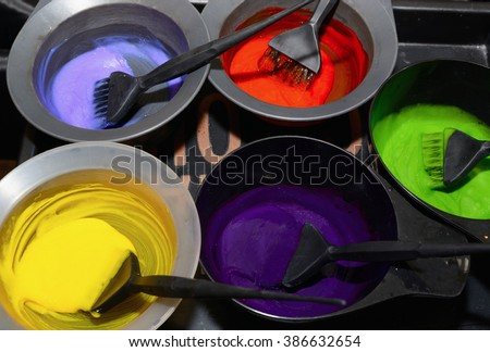 Hair dye in bowls and brush for hair coloring - stock photo